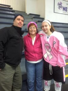 Jackie Kilar with her mom Joan and her father at a cancer awareness hockey game